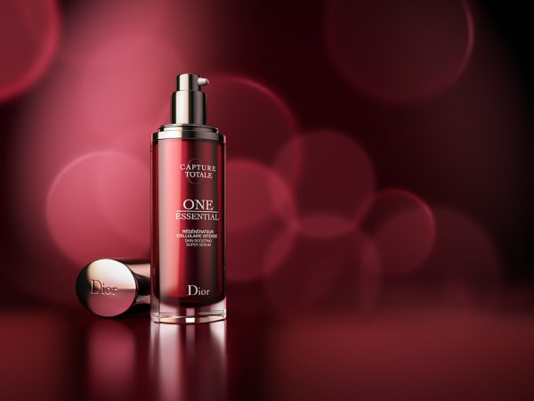 CGI Dior One Essential cream on red background