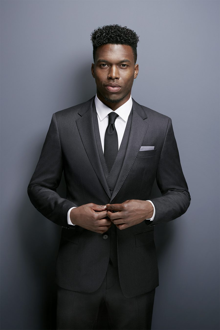Retouched Daniel Sturridge in black suite for Hugo boss