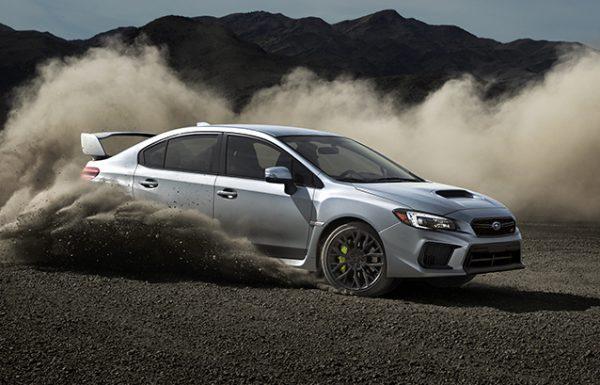 Retouched Subaru car skidding across gravel in desert