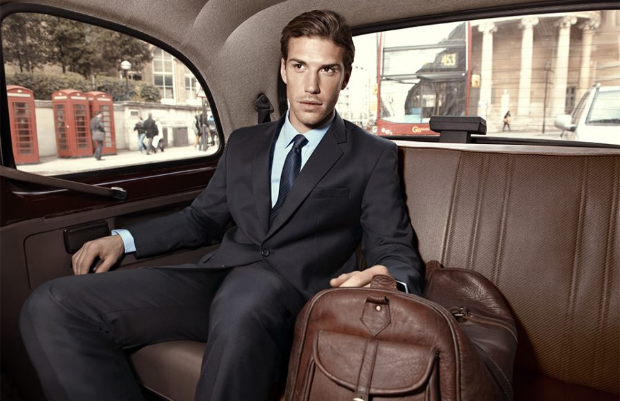 Retouched Man in Bombay High suit riding in the back of a car