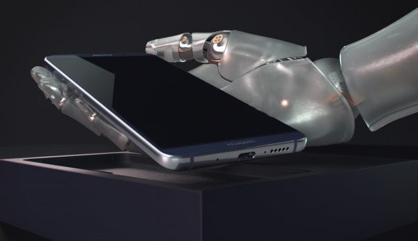 A CGI robot hand holding a Huawei Mate10 Pro Phone