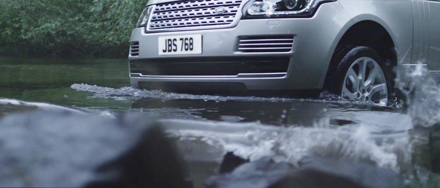 Car driving through lake