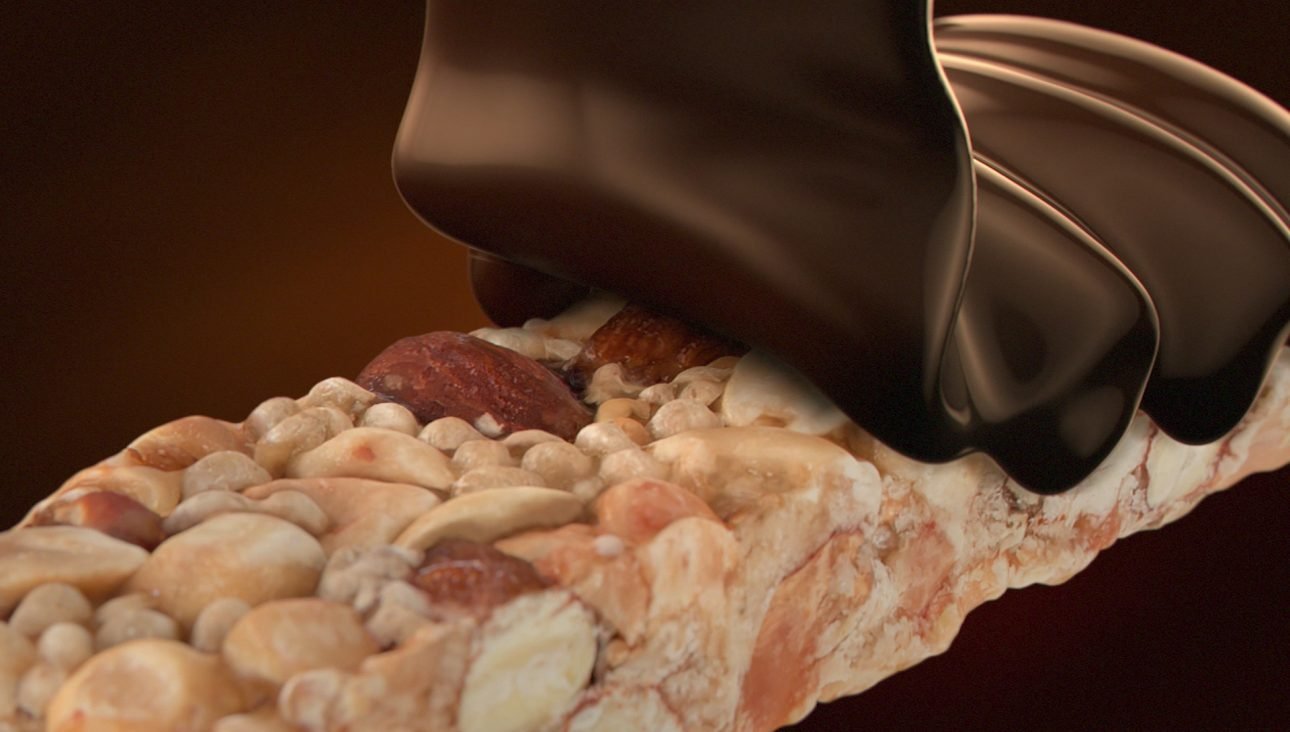 A CGI simulated chocolate pour onto nut bar
