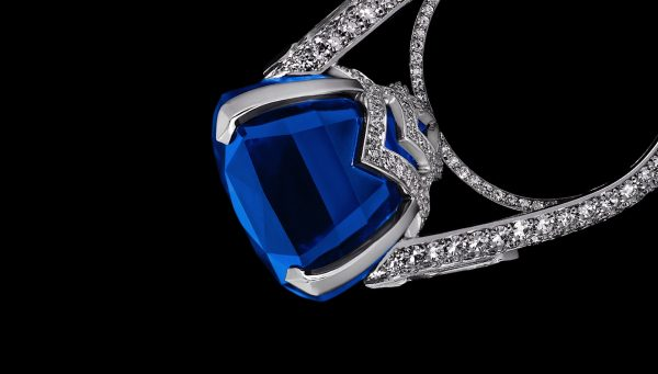 Retouched diamond studded ring with blue gem